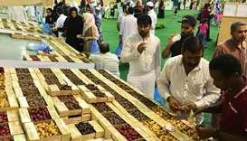 Visitors buying dates at the Local Dates Festival at Souq Waqif