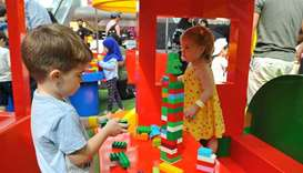 Young children take part in a number of activities at the first Lego festival at Doha Festival City.