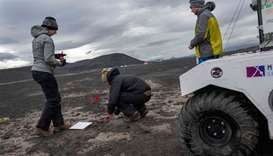 Scientists working at the NASA base at the Lambahraun lava field in Iceland where they are getting t