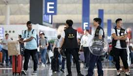 Police patrol the departure hall of the airport in Hong Kong after previous night's clashes with pro