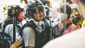 A policeman shouts at a pro-democracy protestor to move out of his way during a gathering in the Sha