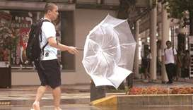 A man makes his way amid strong wind by typhoon Krosa in Miyazaki, Japan.