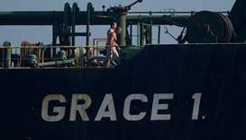 Crew members of Iranian supertanker Grace 1 walk on board off the coast of Gibraltar