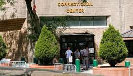 Security personnel and people are seen at the entrance of the Metropolitan Correctional Center jail