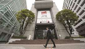 A pedestrian walks past the Tokyo Stock Exchange building in Japan. The Nikkei 225 ended flat at 20,