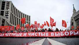 Russian Communist Party members and supporters attend a protest rally against the exclusion of some