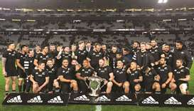 New Zealand's players celebrate after winning the Rugby Championship Bledisloe Cup Test match agains