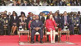 Gabon's President Ali Bongo and his wife Sylvia Bongo attend a parade in Libreville yesterday.