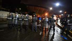 National riot police guard the Tiburcio Carias Andino stadium, where fans rioted in Tegucigalpa, Hon