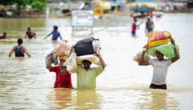 Landslides and floods kill 18 in northern India