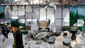 Workers of a wedding hall inspect after a blast in Kabul, Afghanistan