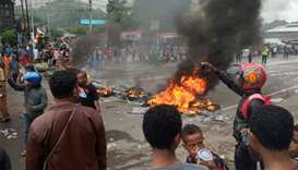 People burn tires during a protest at a road in Manokwari, West Papua, Indonesia