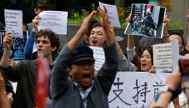 "People hold placards reading ""Taiwan support Hong-Kong"" and ""support Democracy, Freedom, and Human R"
