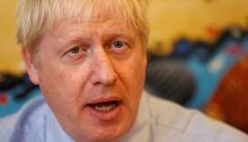 Britain's Prime Minister Boris Johnson talks as he meets with health professionals during his visit