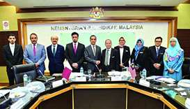 Officials from the Qatar's ministry of education and higher education and the Malaysian ministry of