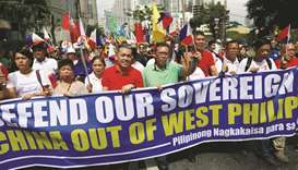 File photo taken on April 9, shows Filipino activists and opposition leaders marching to protest the