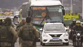 The bus in which a gunman held 31 hostages before being shot dead by police is being taken away, in