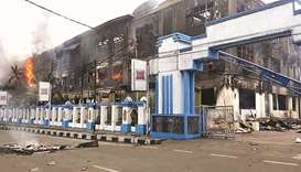 A burnt-out building is seen in Sorong yesterday, after it was set on fire by rioting demonstrators.