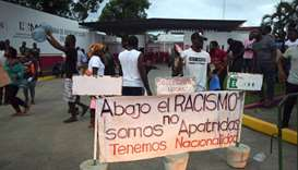 Migrants from Haiti and Africa protest outside the Siglo XXI immigrant detention center