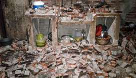 A wall of a villager's house collapsed after a strong earthquake hit Sukasari village in Lebak, Bant
