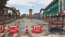 The clock tower is seen at the deserted Lal Chowk during a security lockdown in Srinagar.