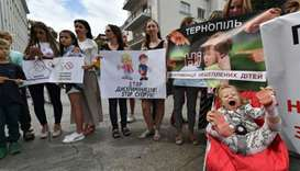 Ukraine anti-vaccine protesters insist on rights despite measles outbreak
