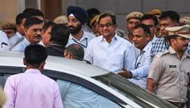 Ex-finance minister Palaniappan Chidambaram (C in white shirt with glasses) leaves a court in New De