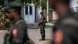 Soldiers stand guard outside St. Sebastian Church, days after a string of suicide bomb attacks acros