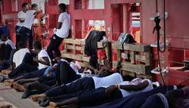 Rescued migrants rest aboard the Ocean Viking, run by French charities Medecins Sans Frontieres and