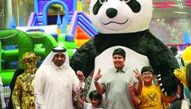 Visitors to the Summer Entertainment City in the company of a 'Panda' (supplied picture).