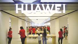 Huawei says US curbs to cut unit's revenue by over $10bn