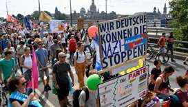 Thousands march against racism in German City ahead of key state polls