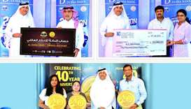 Doha Bank officials with the latest winners.