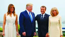 Macron (2ndR) and his wife Brigitte Macron (R) pose with Trump (2ndL) and US First Lady Melania Trum