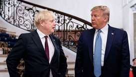 US President Donald Trump (R) and Britain's Prime Minister Boris Johnson speak before a working brea