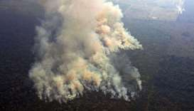 Aerial picture showing smoke from a two-kilometre-long stretch of fire billowing from the Amazon rai