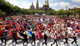 Couples dance to Mariachi traditional music to break the Guinness World Record of largest Mexican fo