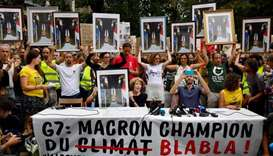 Climate activists fined for stealing Macron portraits