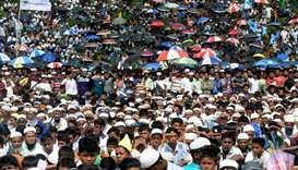 Rohingya refugees attend a ceremony organised to remember the second anniversary of a military crack