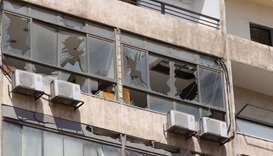 Broken windows are pictured after an Israeli drone fell in the Hezbollah-dominated southern suburbs
