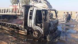 A handout picture released by the Hashed al-Shaabi force shows the wreckage of a vehicle at the site