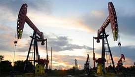 Pumpjacks are seen during sunset at the oil field