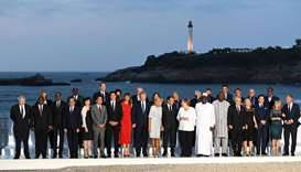 Leaders pose for a photo with invited guests during the G7 summit in Biarritz, France