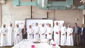 Commercial Bank and Aspire Zone Foundation (AZF) officials.