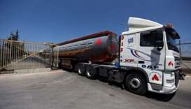 A fuel tanker leaves the Gaza power plant in the central Gaza Strip