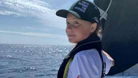 Swedish 16-year-old activist Greta Thunberg stands on the bow of the Mazilia II racing yacht