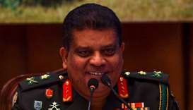 Sri Lanka's new army chief Lieutenant General Shavendra Silva reacts as he speaks during a press con