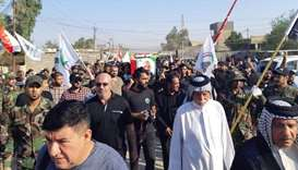 Iraqis and members of the Hashed (Popular Mobilisation units) taking part in the funeral procession