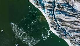 High above Greenland glaciers, NASA looks into melting ocean ice