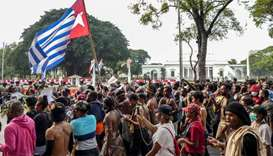 Papuans take part in a rally in front of the presidential palace and army headquarters in Jakarta